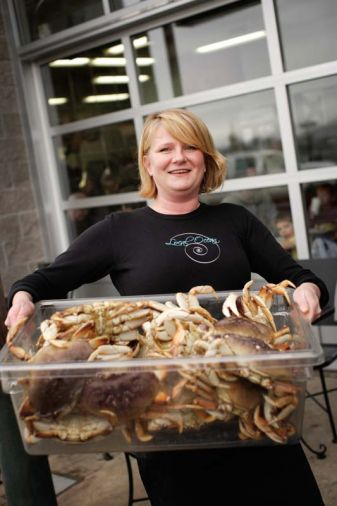 Laura Anderson of Local Ocean showcases the daily catch. Purists will want to order the two pound whole cooked crab in the shell. On blustery days, warm up with the soul-satisfying Roasted Garlic and Dungeness Crab Soup.