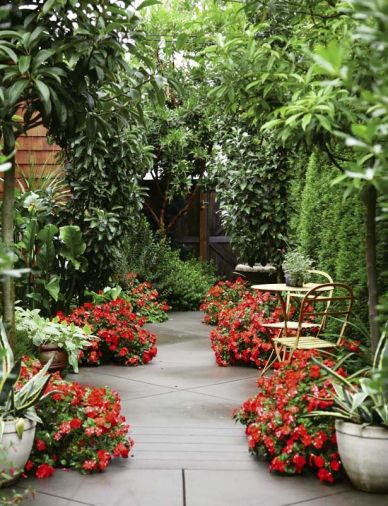 Fiery impatiens are the final touch to this creative, yet secluded, setting for small café-style tables.