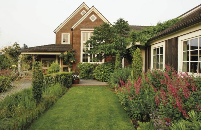 Using an easy-care palette of plants selected for texture, Michael was also able to direct guest traffic around the exterior spaces, linking decks, porches, and arbors to lure visitors from one area to another.