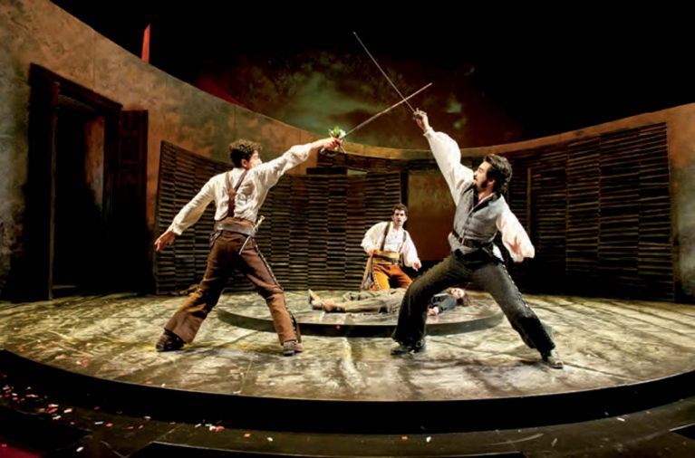 Romeo (Daniel José Molina) and Tybalt (Fajer Al-Kaisi) fight for the honor of their families as Benvolio (Kevin Fugaro) watches over the fallen Mercutio (Jason Rojas) in <em>Romeo and Juliet</em>, part of Oregon Shakespeare Festival's live theatre lineup.