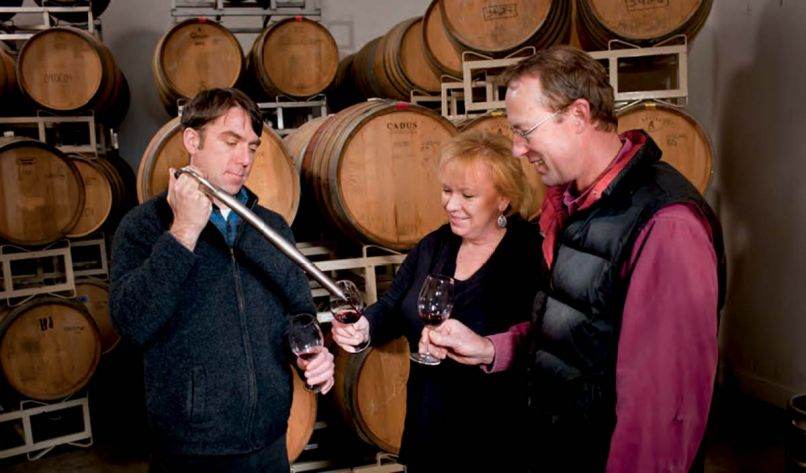 At Agate Ridge Winery owner Kim Kinderman and vineyard manager Jon Meadors get a barrel sample from winemaker Brian Denner.
