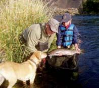 Fly Fisher's Place guide Steve Erickson helps a young client with a steelhead to remember.