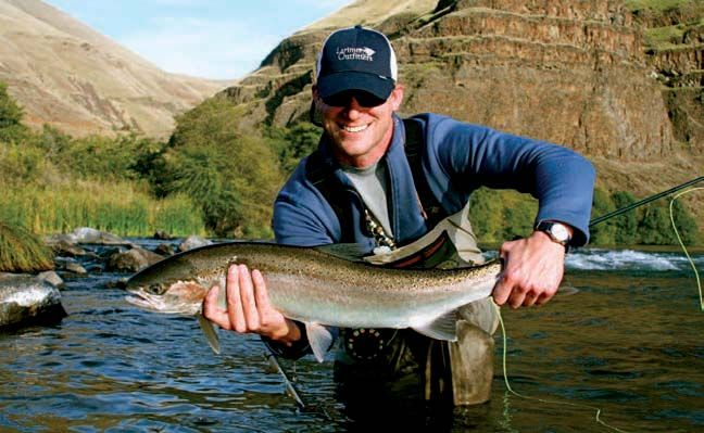 Jeremy Hull with a 10 lb Deschutes River wild summer steelhead.