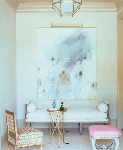 The furniture of Kasler's own entryway may be antique but it is far from stuffy, with polka dots on the chair and pink leather on the stool – a color that reappears in other rooms in the home. The painting is by Steven Seinberg.