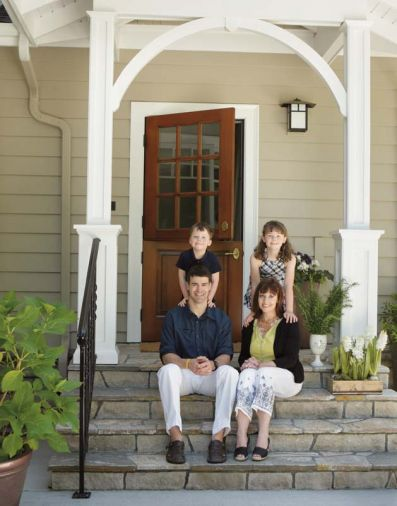 Portlanders Shawn and Sandy Patrick sit with their children, MacLean and Anna Blake, on the steps of their mudroom addition designed by Ann McCulloch.