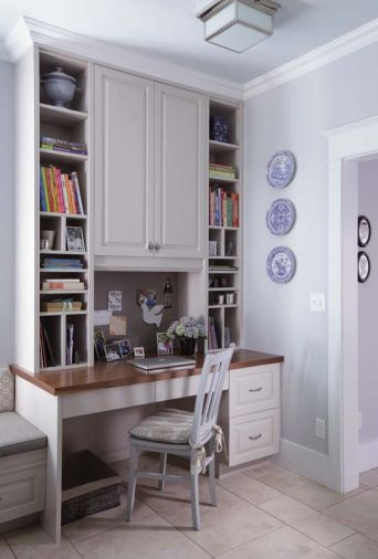 A built-in kitchen desk takes up less room than the stand alone type, and can provide easy-to-reach storage for colorful cookbooks, planners and office work.
