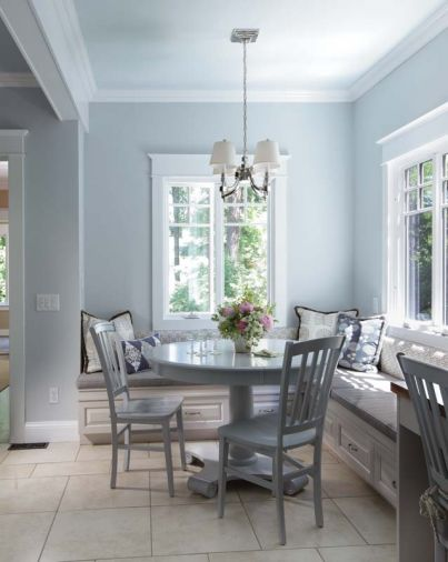 The tall French casement windows light up the nook area, while providing insulation from weather and sound. The banquette brings family and friends together for conversation around a casual dining/homework/ crafts table. Storage is easily built into the benches. Sturdy outdoor fabrics make pillows and cushions easy-to-clean.