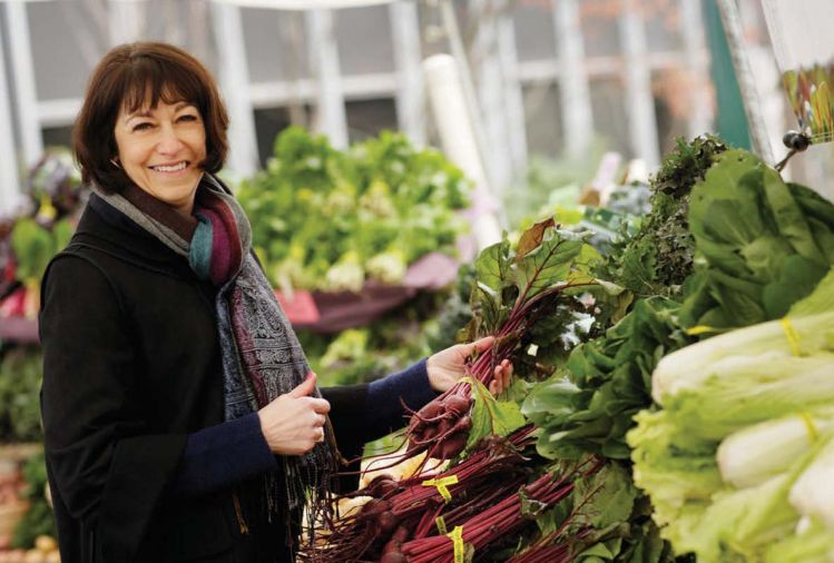Diane Morgan, the author of <em>Roots: The Definitive Compendium</em>, shopping at the Portland Farmers Market.