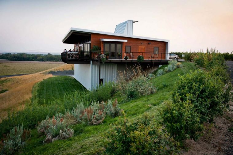 The uniquely designed tasting room at Amavi Cellars offers romantic views of the estate vineyards.