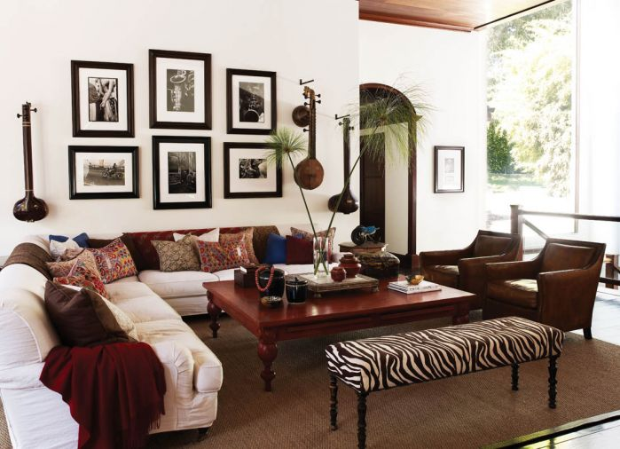 Assorted antique batik and tribal fabric pillows give character to the living room designed for easy entertaining.