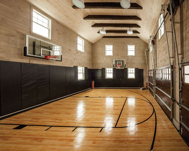 The basketball court that doubles as a three car garage was Rob's idea.