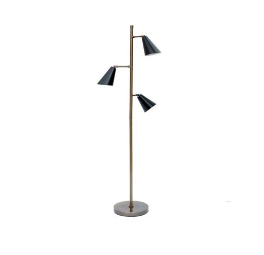 The Maxwell floor lamp, finished in vintage brass and matte black, is MGBW's update on a classic light source.