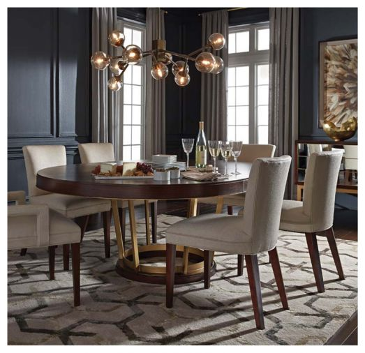 "Crafted from warm walnut veneer and a satin-brass decorative pedestal base, the Delaney table from MGBW expands from a 60"" round shape to a 80"" oval, turning any dinner party into a special occasion."