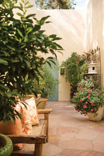 An enclosed courtyard graced with potted plants from Tony Michael in Portland opens to the main hall and the master bedroom.