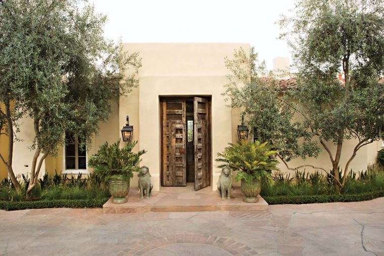 Joelle Nesen of Maison, Inc. transformed this 1997 So Cal estate built by home designers Bob and Jeff Holcombe for her long term Pacific Northwest clients. Her challenge was to marry their individual tastes into one harmonious vision for Southern California living. A pair of lofting olive trees embrace the entrance, where oversized antique Spanish wooden doors, guarded by a pair of antique bronze Cambodian Foo Dogs, purchased when the couple were married in Cambodia, open up a whole new world for the Northwest couple.