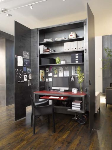 The custom home office sits on wheels and can be closed up and rolled out of the way on tracks set in the floor.