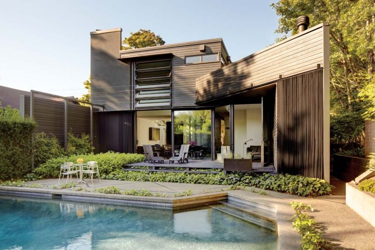 The reworked south façade lets light in through the innovative jalousie window and permits easy egress to the pool and backyard.