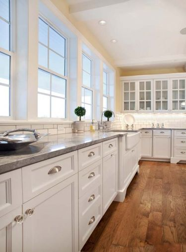 Classic chrome cup pulls were used on the drawers in the kitchen, but Morr added a special touch with crystal pulls on the cabinets. They sparkle in this light-filled kitchen.