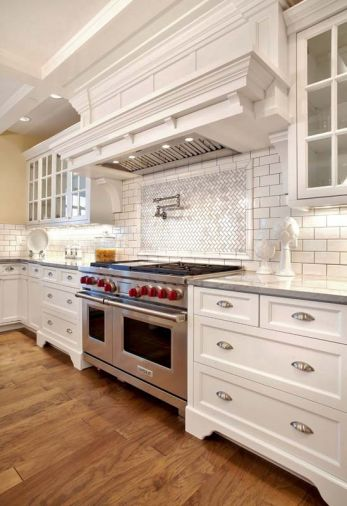 Keeping with the classic feel the homeowners wanted, gleaming white subway tile was selected for the backsplashes.