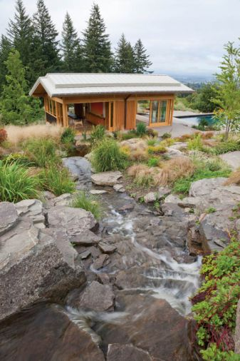 The rocks were imported, and individually placed in the tumbling water feature designed by Eamonn Hughes of Hughes' Water Gardens. Originally from Ireland, Hughes has been designing Zen-inspired water features like this one in Oregon since 1987.