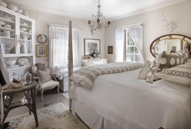 Relaxing shades of white, off-white and soft grays make the master bedroom a soothing retreat. The antique sea grass table reiterates the painted warm gray fir floors. V-groove walls and ceilings are original, and repainted. Bedding is from Sesame + Lilies.