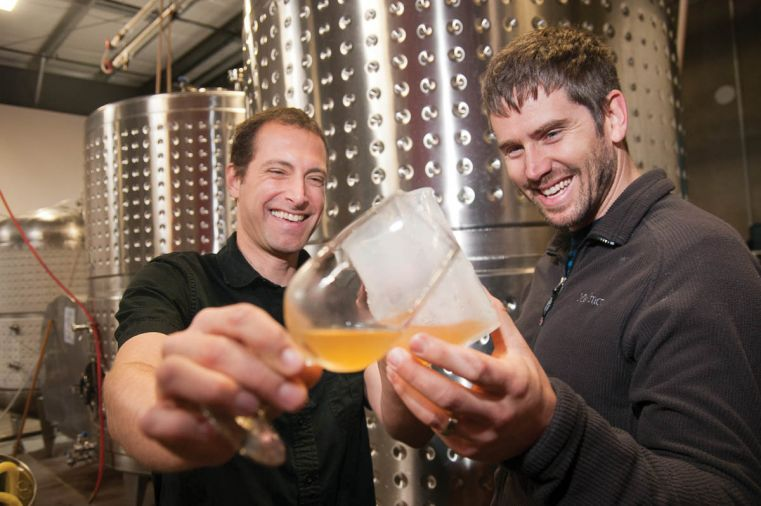 Nick Gunn and James Kohn toast to the continued success of Wandering Aengus. Though their ciders never contain any artificial additives or flavors, Wandering Aengus is continually experimenting with new ciders made by blending apples with other fruits, herbs, or spices.