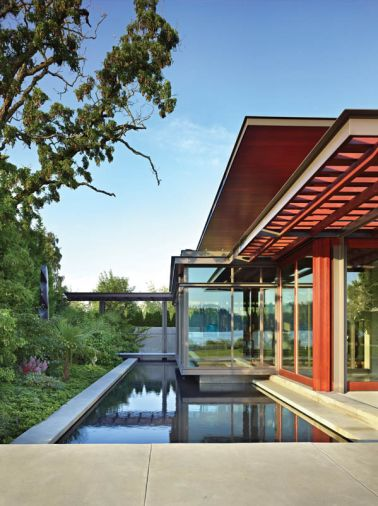 The north end of the Pavilion House cantilevers over a reflecting pool and a lush paradise garden for spring and summer viewing enjoyment. Landscape architecture by Charles Anderson.