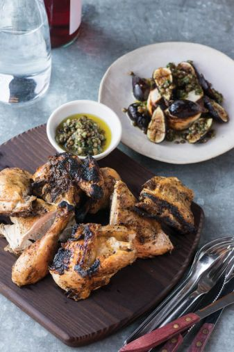 Ox Restaurant's <strong><a href='grilled-butterflied-whole-chicken-with-grilled-figs-manouri-cheese-and-lentil-chimichurri'>Grilled Butterflied Whole Chicken with Grilled Figs, Manouri Cheese and Lentil Chimichurri</a>.</strong> This recipe uses an indirect heat method that is one of the foundations to open-fire cooking in South America.