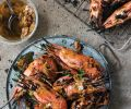 "Ox Restaurant's Grilled Head-On Spot Prawns with Garlic, Green Onion and Sumac. ""Grilling restaurant- worthy fish barely requires any preseasoning, skinning or shelling,"" write Greg Denton and Gabrielle Quinonez Denton."