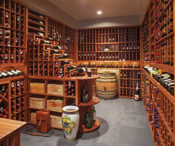 Ron Cowan of Stellar Cellars built the wine cellar with mold and mildew resistant African Sapele wood, featuring a peninsula with cascading bottles, individual bottle storage with cleats, diamond racking below - all held together with wooden dowels and glue for strength.