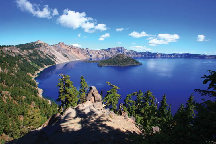 Crater Lake, high in the Cascade Mountains, is Oregon's shimmering blue gem. It's a must-see landmark during any trip to Southern Oregon.
