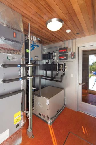 A central utility room off the garage gives easy access to all of the home's systems, including the heat pump, 2,400 gallon UV-purified rainwater reclamation system, under-floor radiant heating, and pool systems.