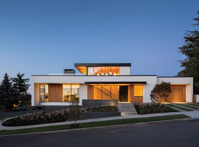 Viewed from the street, architect Tim Eddy's Southeast Portland home almost appears to float above the ground. Fusing contemporary style with cutting edge sustainability features and alluding to a few traditional touches, Tim designed his home to create the kind of life he and his wife, Joyce Bell, wanted to live. From the entryway to the rooftop terrace and viewbox reading room, the Eddys  home is filled with delightful spaces for real life: working, cooking, reading, entertaining, relaxing and enjoying the outdoors.