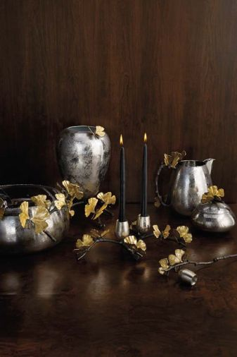 The Butterfly Gingko Collection is inspired by delicate leaves that resemble butterfly wings. Each cocoon-shaped vessel is adorned with handcrafted brass 'butterflies.'