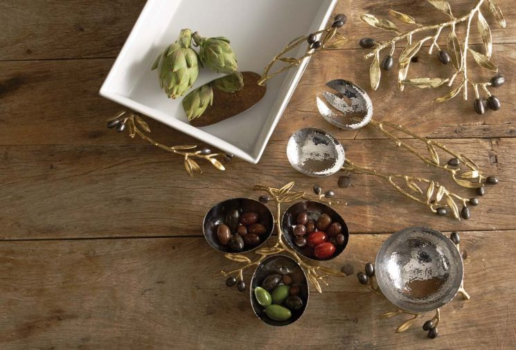 Elegant serving pieces from Aram's Olive Branch Collection capture the essence of his work – simple and functional objects that are also extraordinarily sculptural and organic.