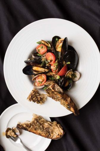 Try a taste of the Islands at home with Steamed Clams and Mussels with Garlic, Onions, Scallions, Baby Tomatoes, and Sherry from Executive Chef Raymond Southern of The Mansion Restaurant at Rosario Resort and Spa.