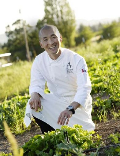 JORY Restaurant Executive Chef Sunny Jin harvesting fresh herbs from the one-acre chef's garden.