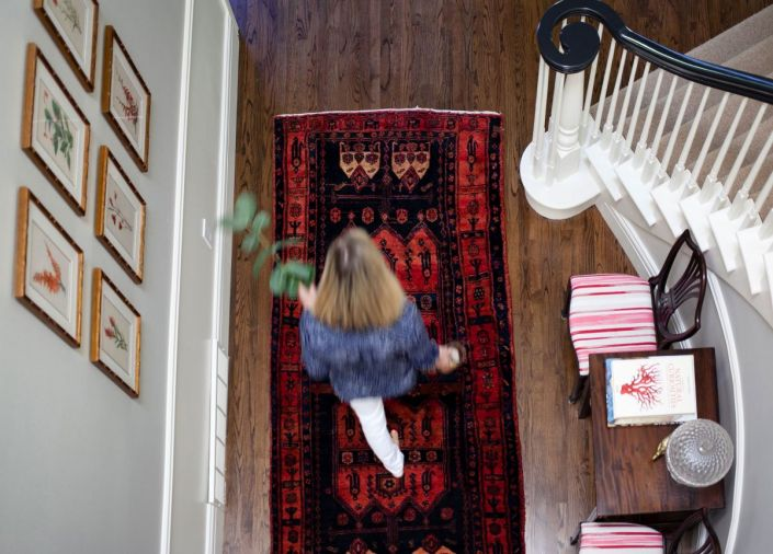 Warm oriental rugs are incorporated throughout the home. 