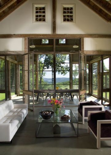 Steel and glass doors open up the barn on three sides to reveal stunning vistas