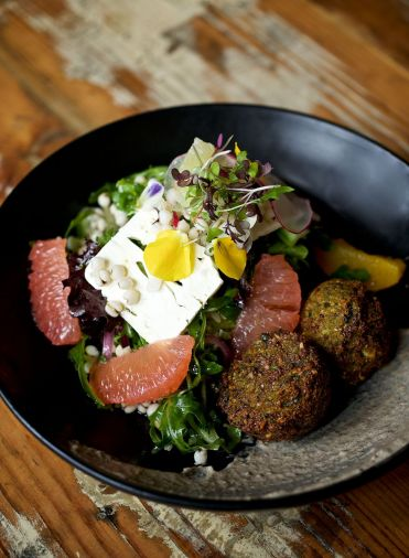Freekeh Bowl with Chickpea Quinoa Fritters, Citrus, Young Lettuce, Feta, Charred Onion Crema