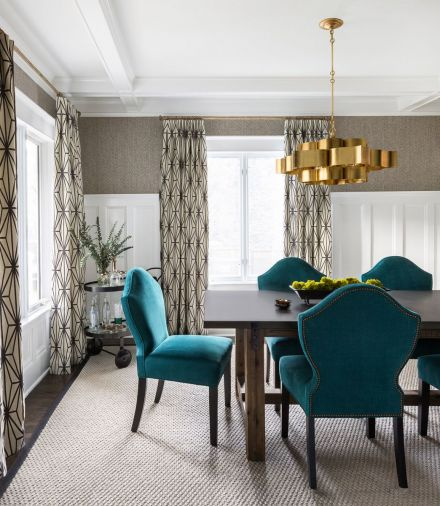 Blues and yellow in the family gathering room and brass and turquoise in the formal dining room give the rooms a lively infusion of color.