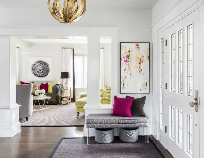 Located by the front entryway, the living room's facelift not only included new paint but also a new granite surround for the fireplace. Created with the adults who would be using it in mind, furnishings here were deliberately chosen to have a more glamorous Hollywood-like aura than they have in the rest of the house. Chartreuse and magenta provide strong and warm colors against the cooler white and grays.