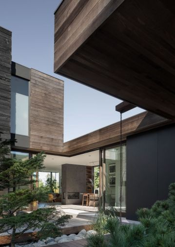 Extending the siding into the interior of the house creates a sense of continuity while drawing attention to the craftsmanship that went into the home. Planned sight lines take advantage of borrowed landscapes at the horizon. 